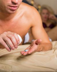 Male taking male enhancement pill