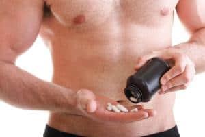 man taking enhancement supplements