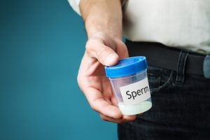 sperm sample in a cup
