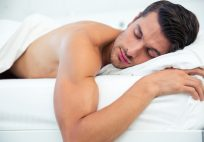 shirtless man sleeping